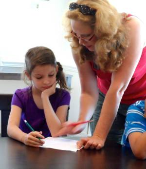 Working with a budding writer at WordSparks Camp