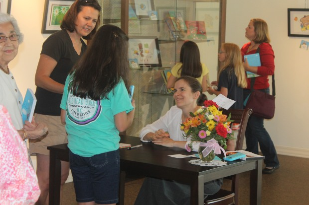 Cece signing books.